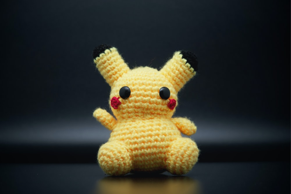 white and yellow bear plush toy