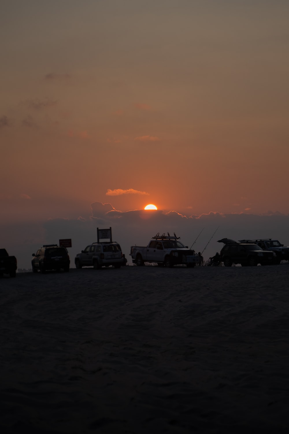 silhouette of cars during sunset