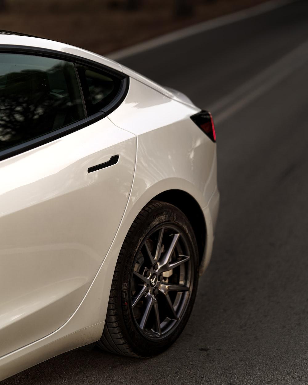 white car on gray asphalt road