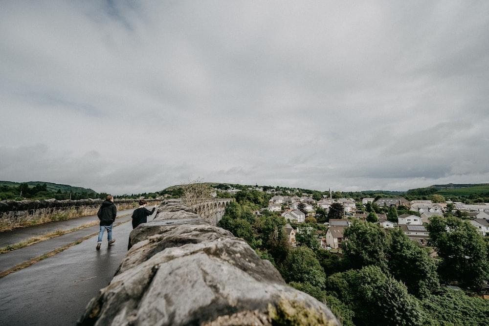 people walking on gray concrete pathway during daytime