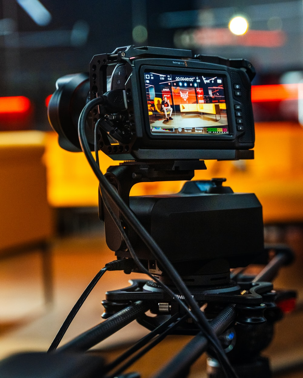 black dslr camera on black stand