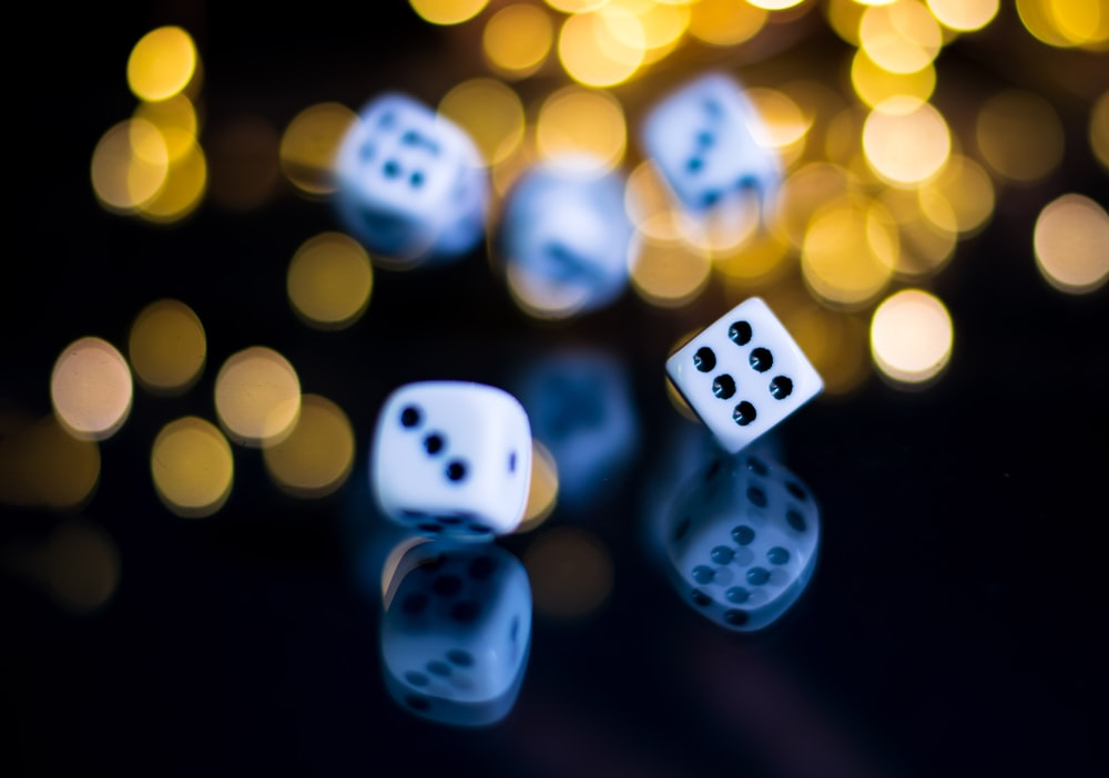 white and black dice with yellow and black bokeh lights