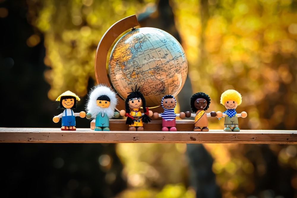 lego mini figures on brown wooden table