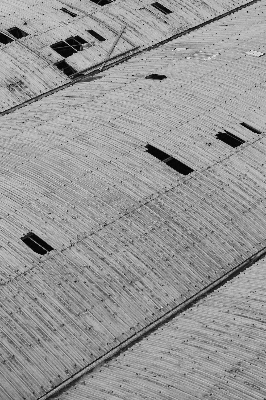 grayscale photo of concrete brick floor