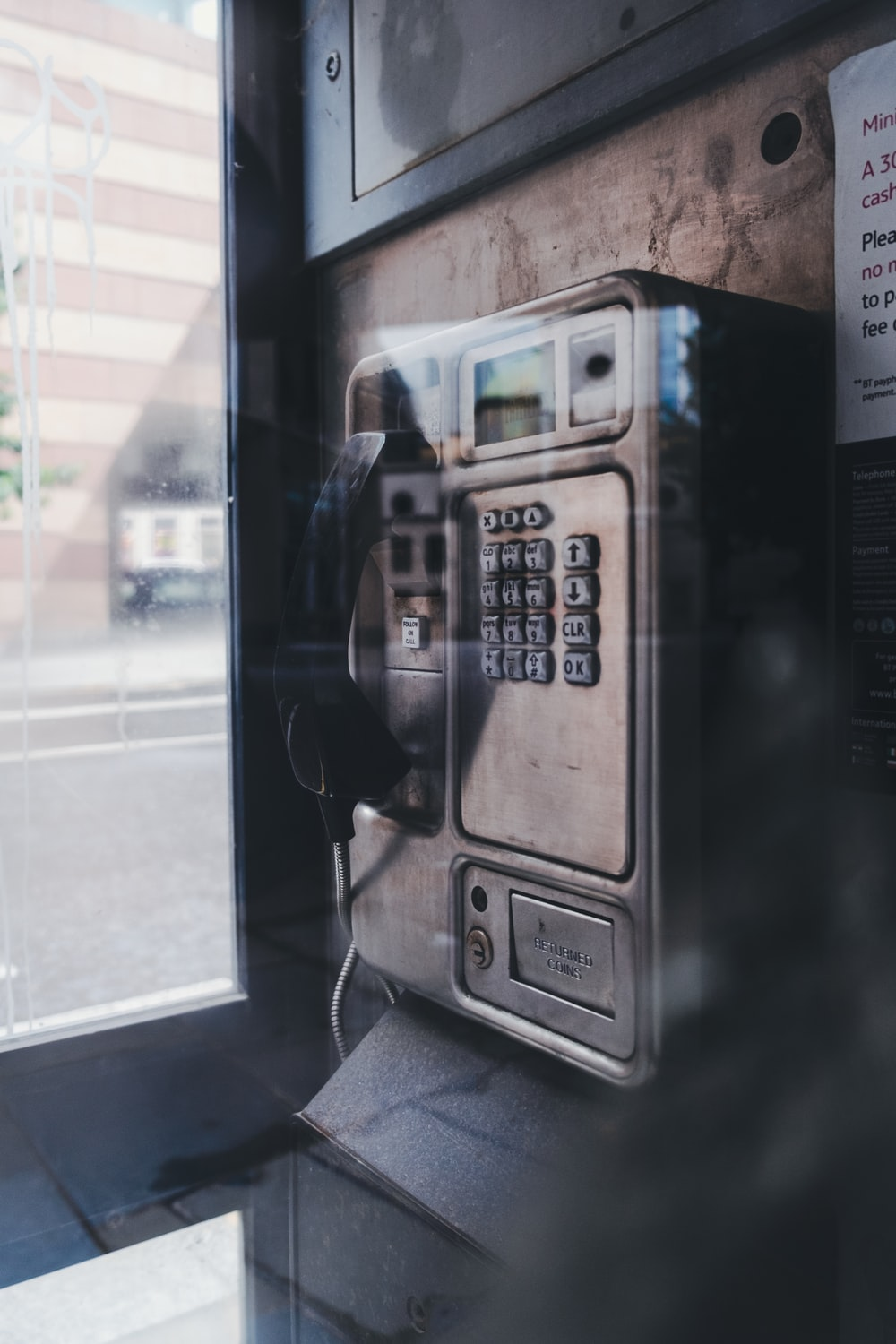 black and silver telephone booth