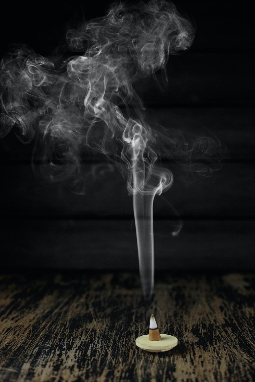 white smoke on black surface