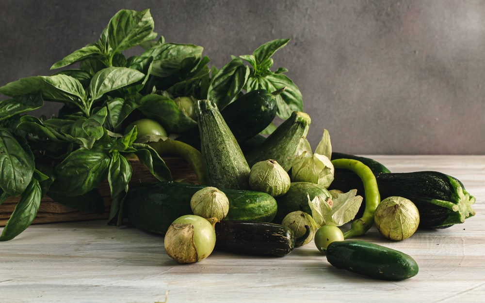 green vegetable on white wooden table