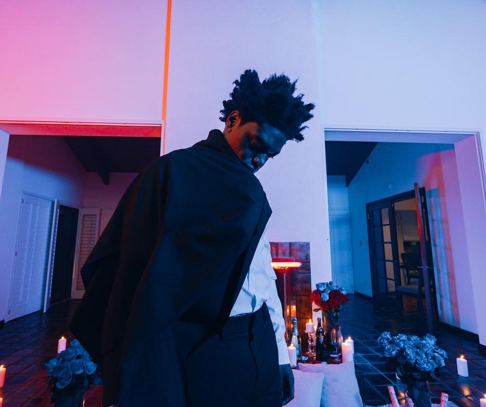 man in black robe standing