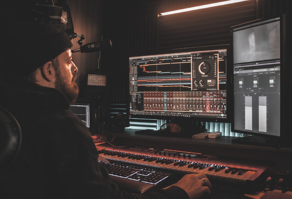 man in black long sleeve shirt playing audio mixer