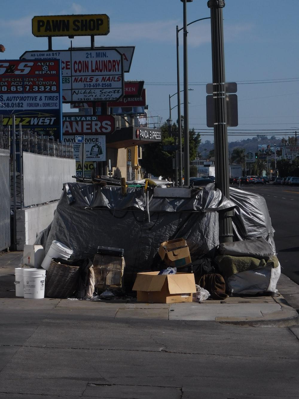 black plastic bag on gray concrete road