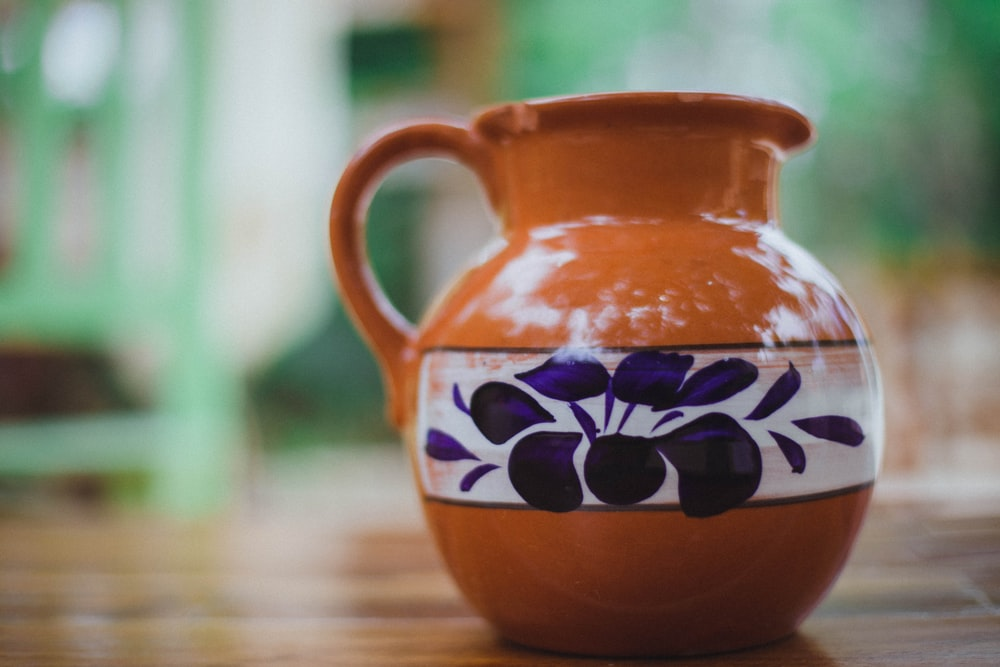 brown and green floral ceramic vase