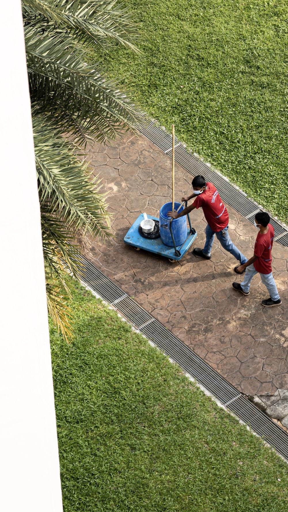 2 boys playing on blue car