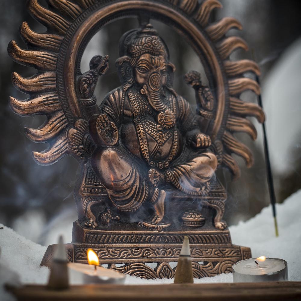 gold buddha figurine on white table