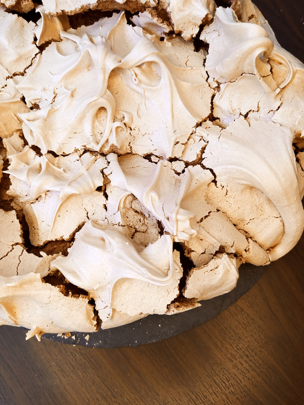 white icing covered cake on brown wooden table