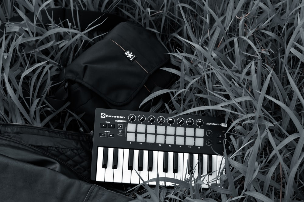black and white electronic keyboard on black leather textile