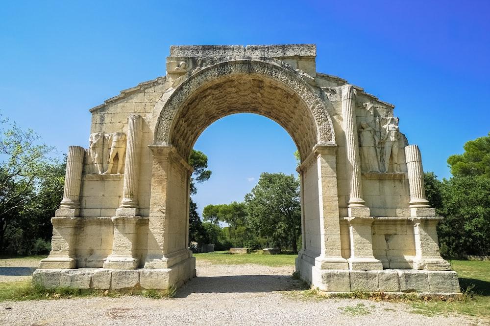 beige concrete arch during daytime