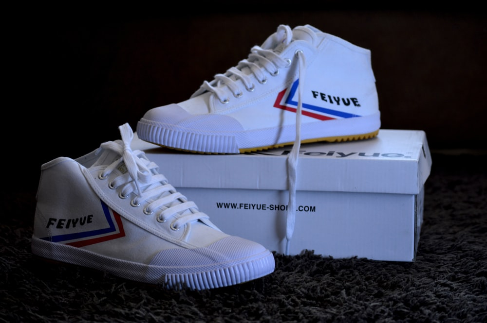 white and blue nike athletic shoes