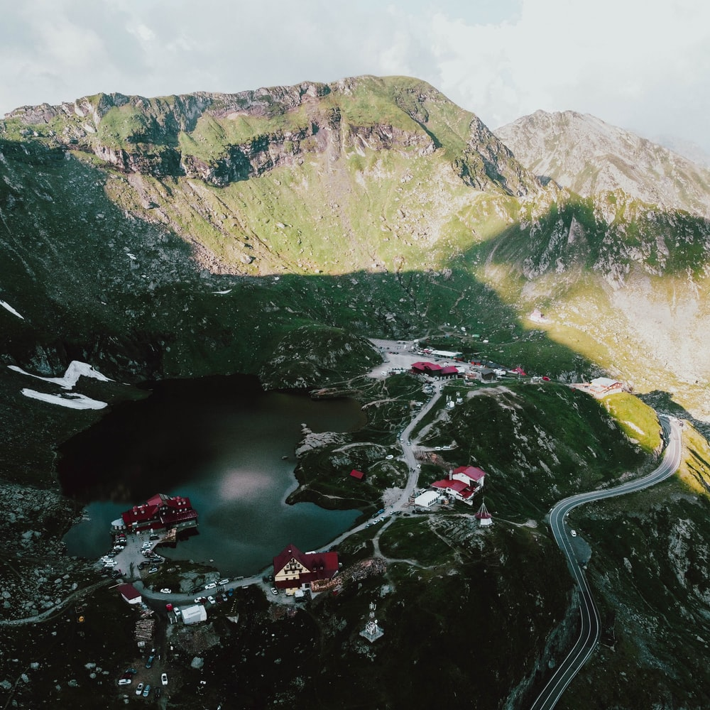 aerial view of river between mountains during daytime