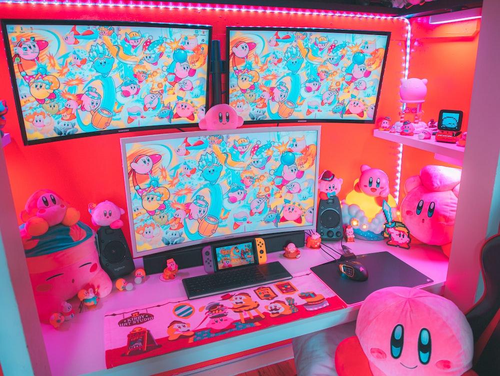black laptop computer on pink bed