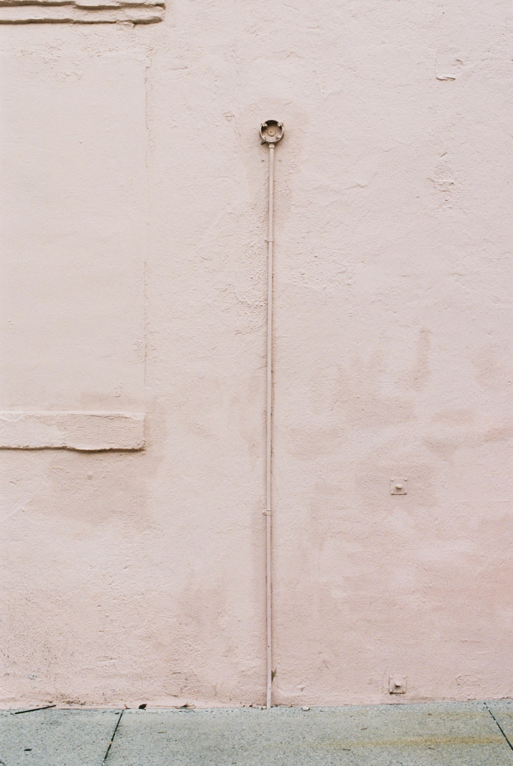 silver chain on white painted wall