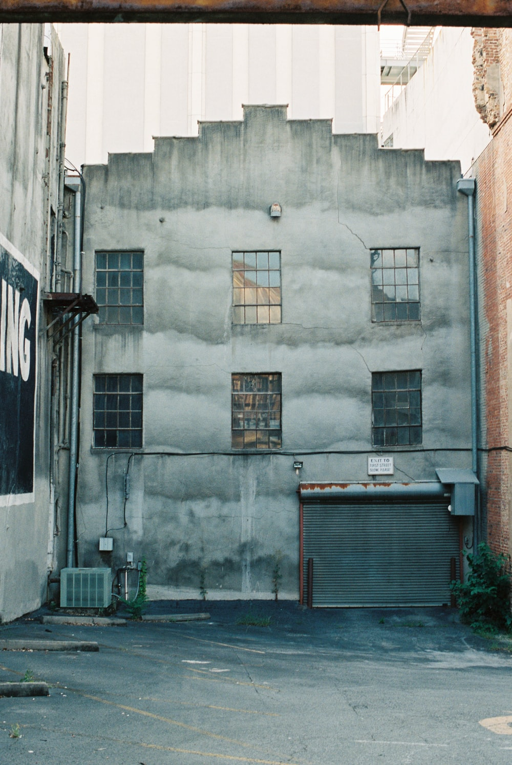 gray concrete building with brown wooden window