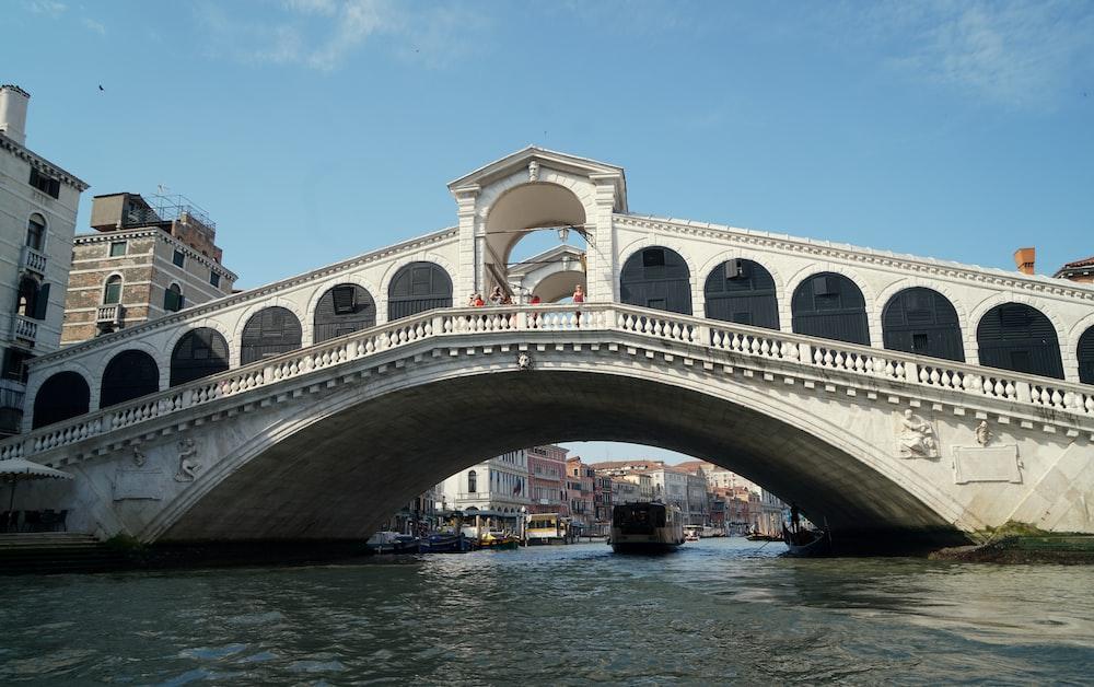 white concrete bridge over blue sea under blue sky during daytime
