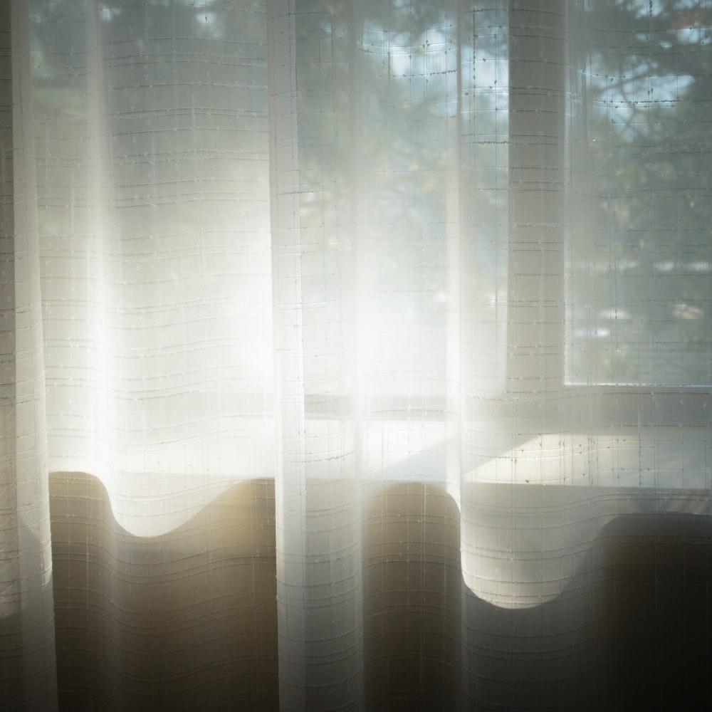 white sheer window curtain during daytime