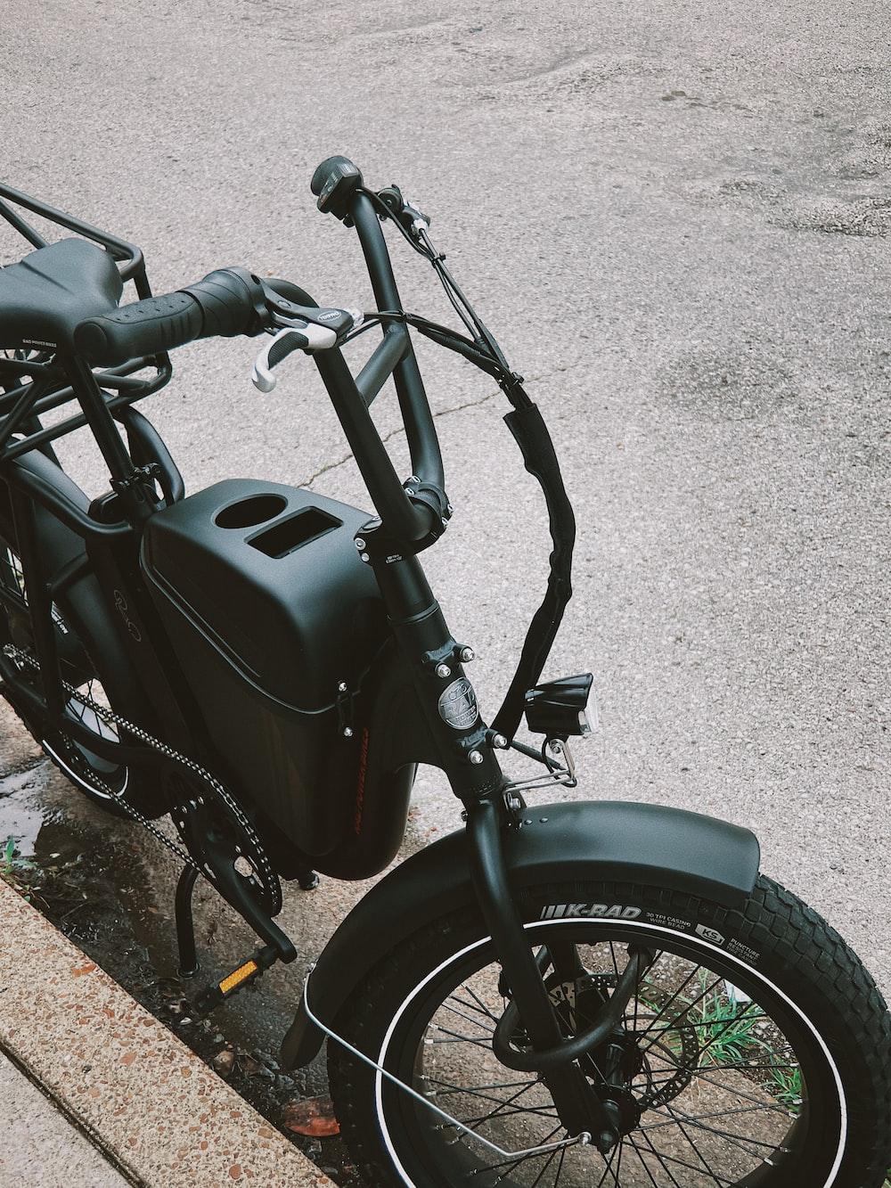 black motorcycle on gray concrete floor