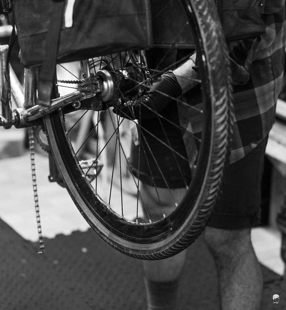 grayscale photo of bicycle wheel