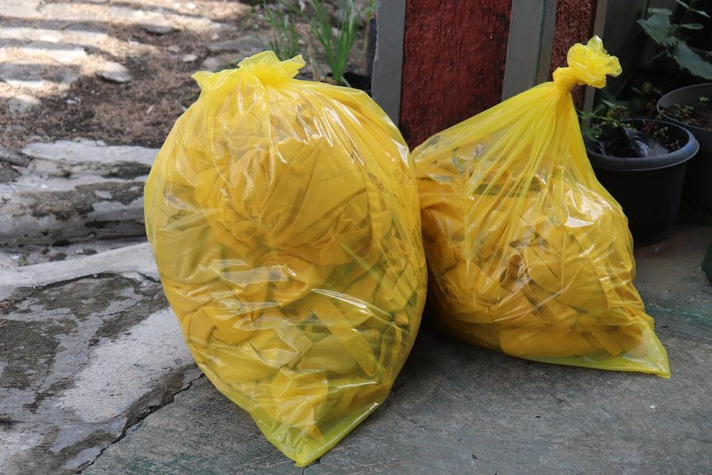 yellow plastic bag on gray concrete floor
