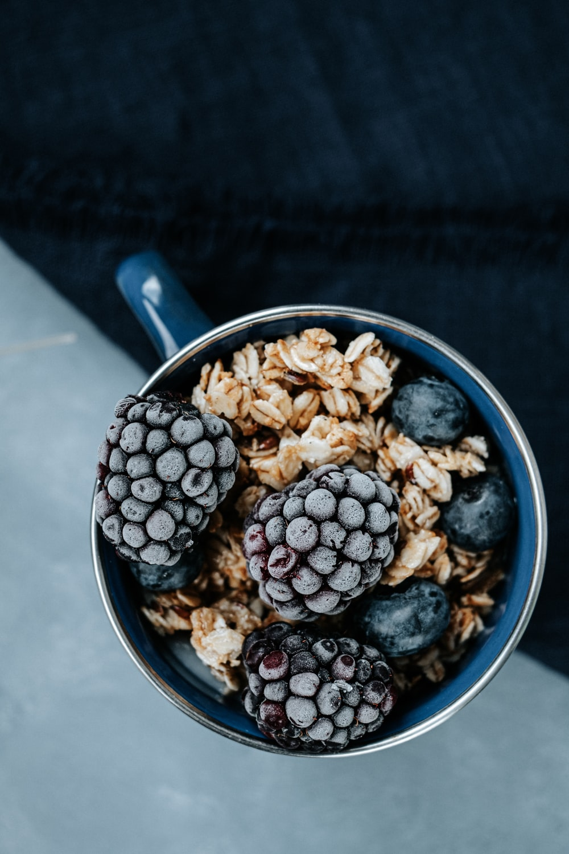 blue ceramic bowl with black berries