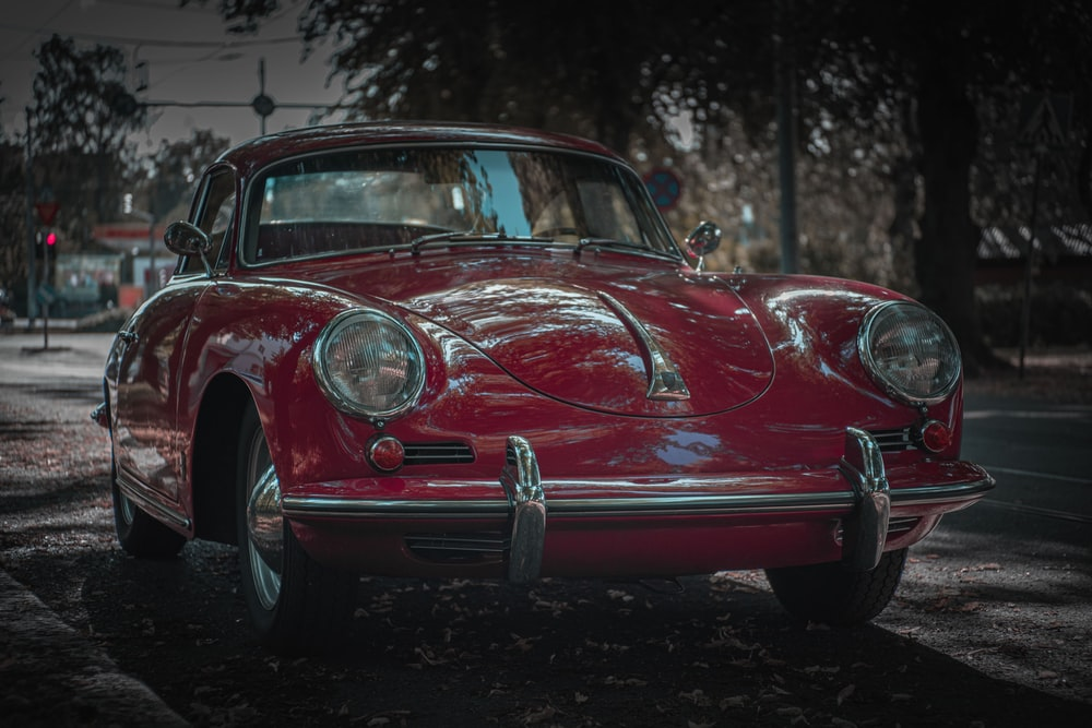 red classic car parked on the street
