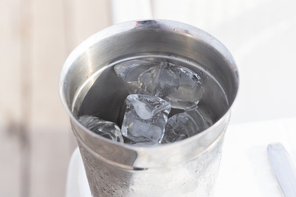 stainless steel bucket with ice