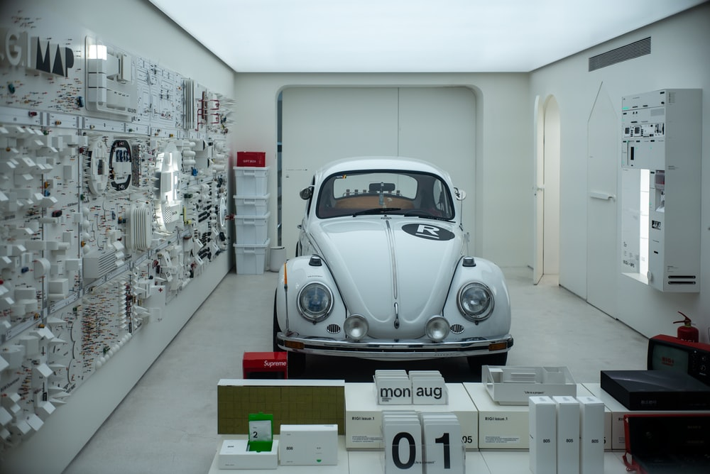silver volkswagen beetle parked in building
