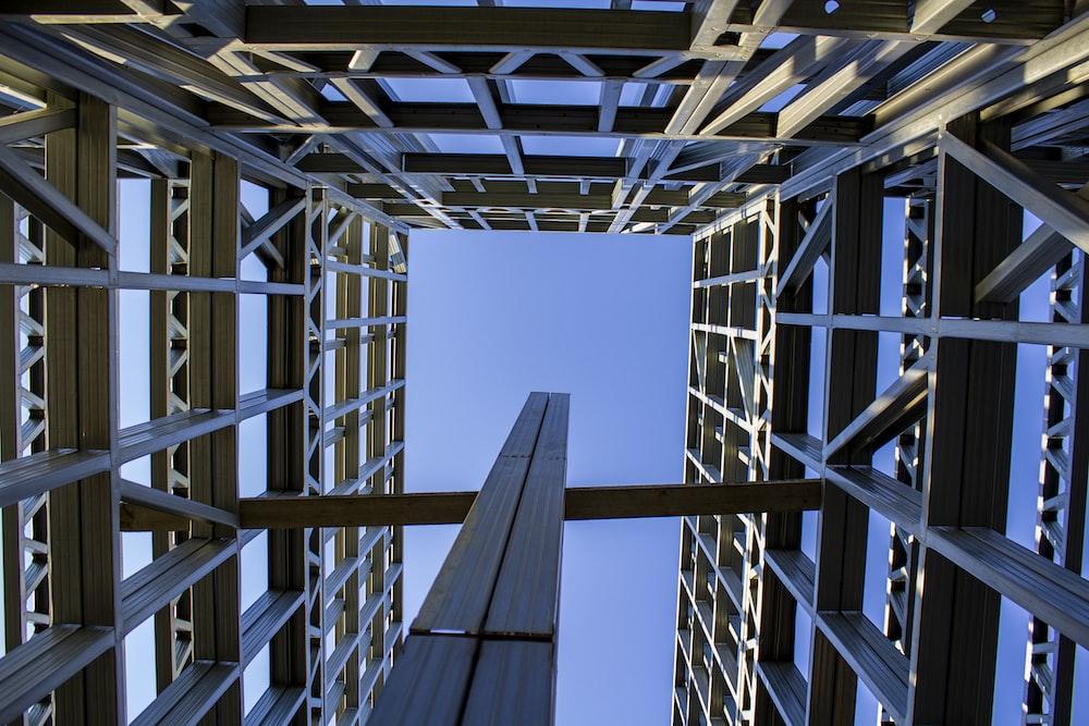 gray metal frame under blue sky during daytime