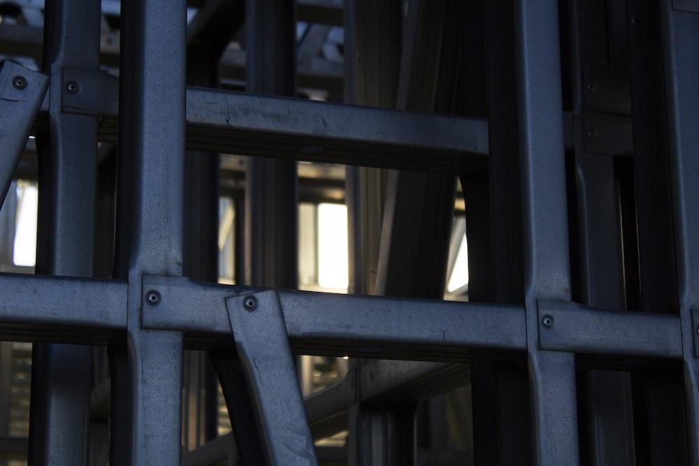 black metal frame near brown concrete building during daytime