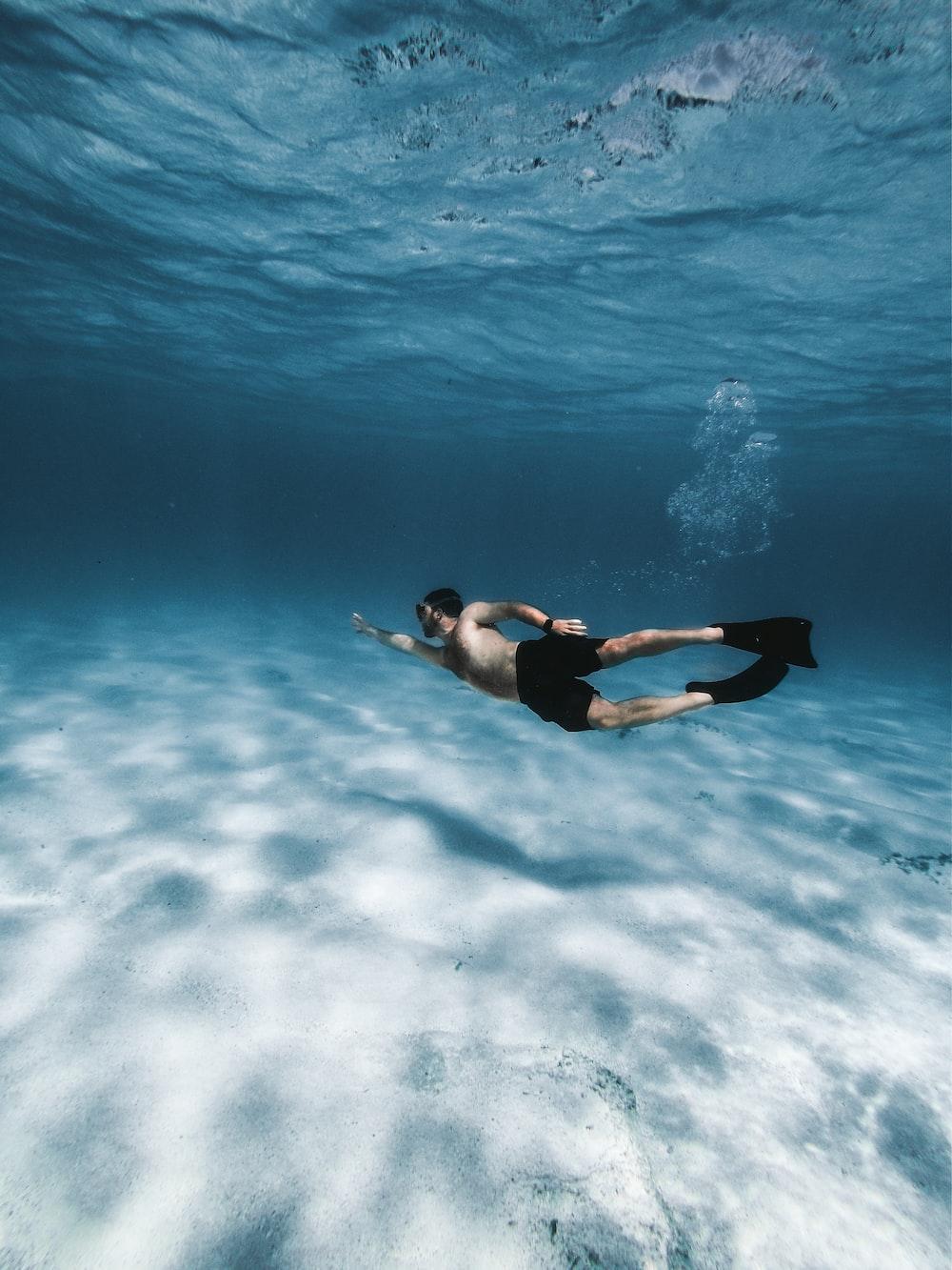 woman in black bikini in water
