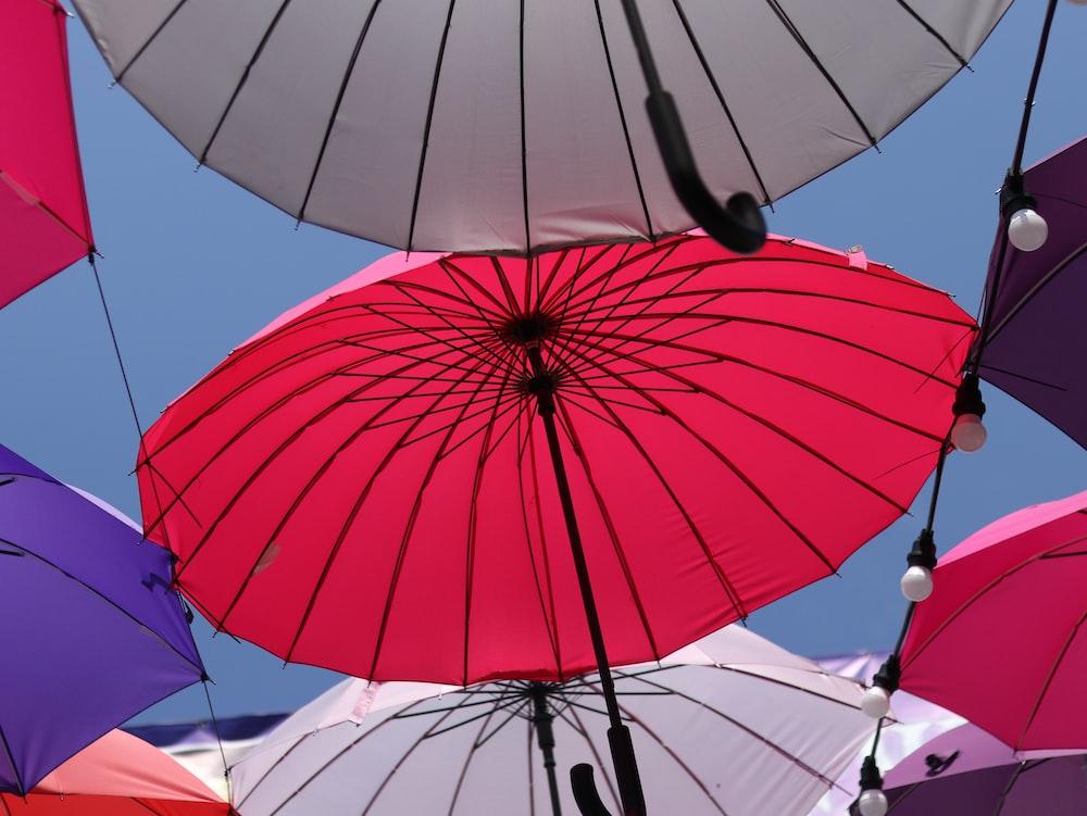 red umbrella under blue sky during daytime
