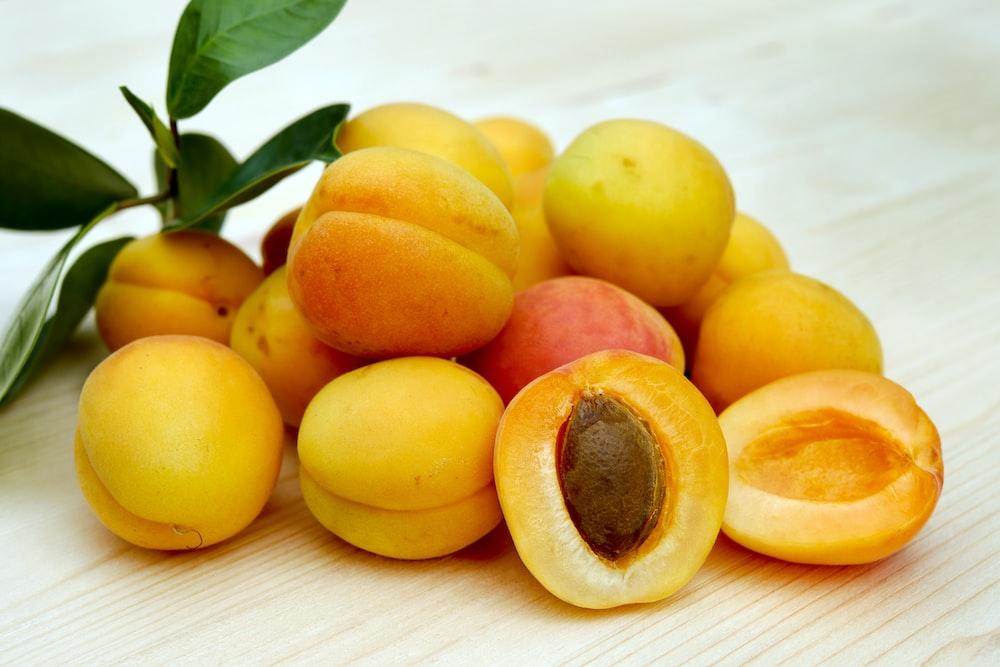 yellow round fruits on white table