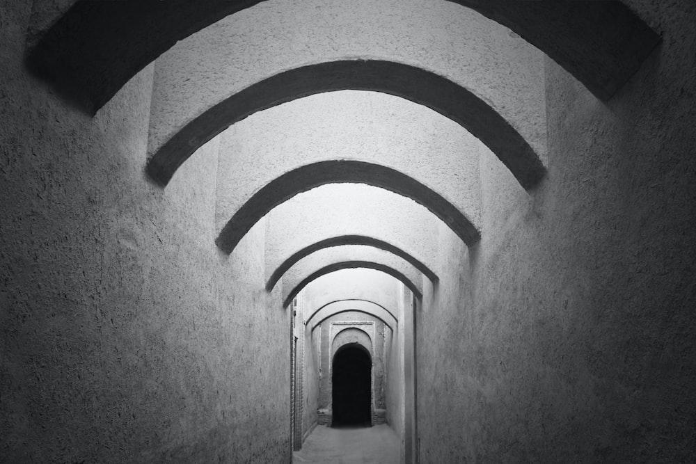 gray and white brick tunnel