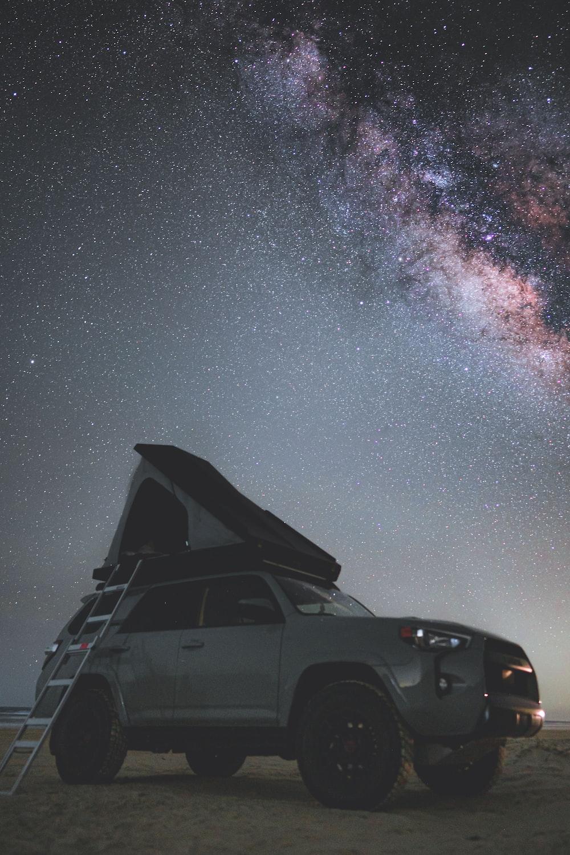 black suv under starry night