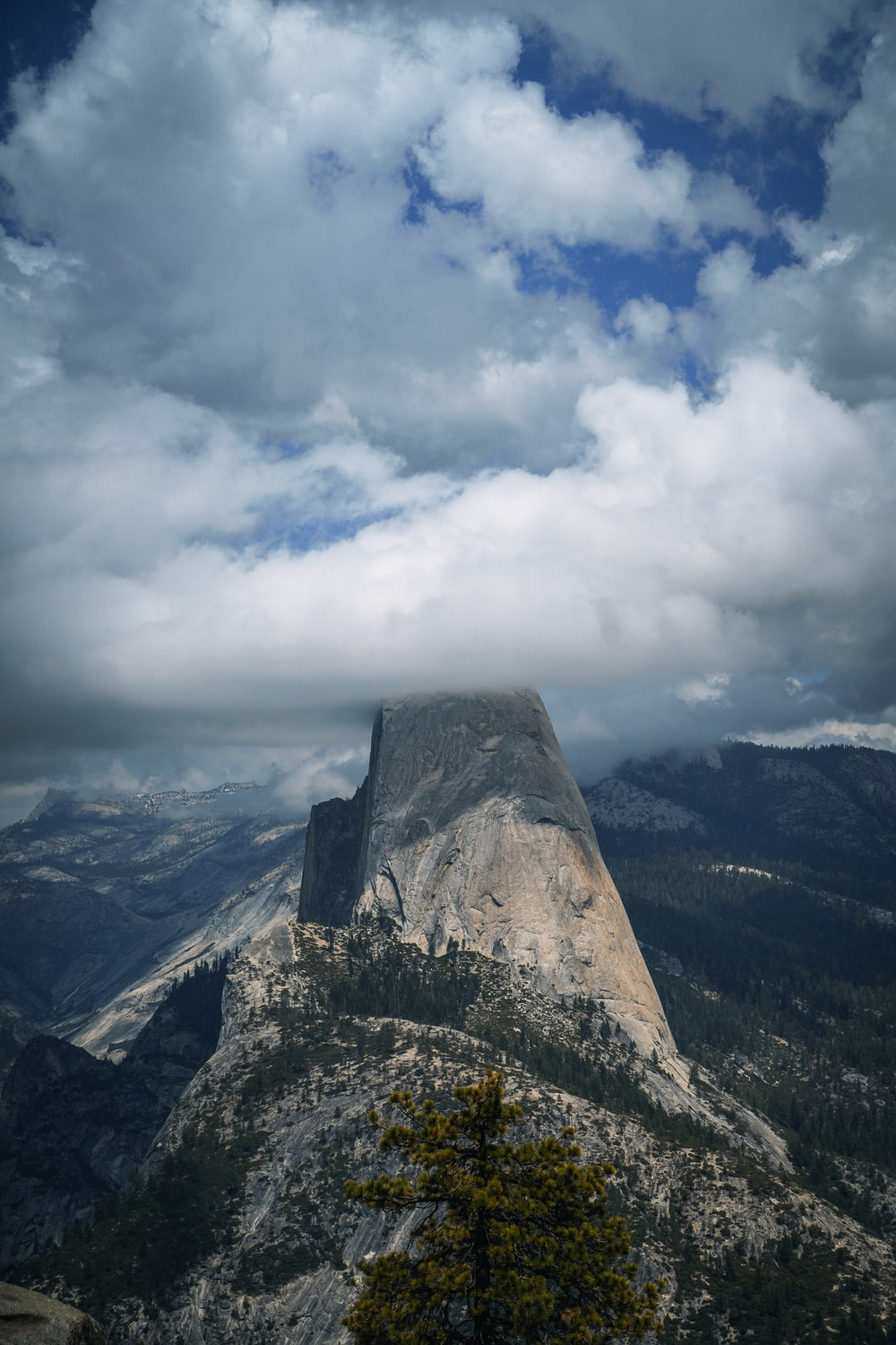 gray rocky mountain under white clouds during daytime