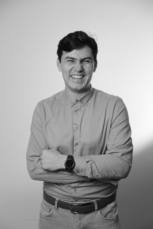 man in dress shirt smiling