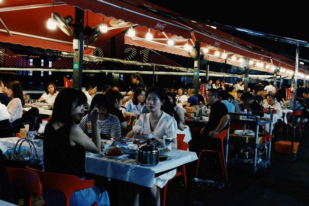 people sitting on chair near table during night time