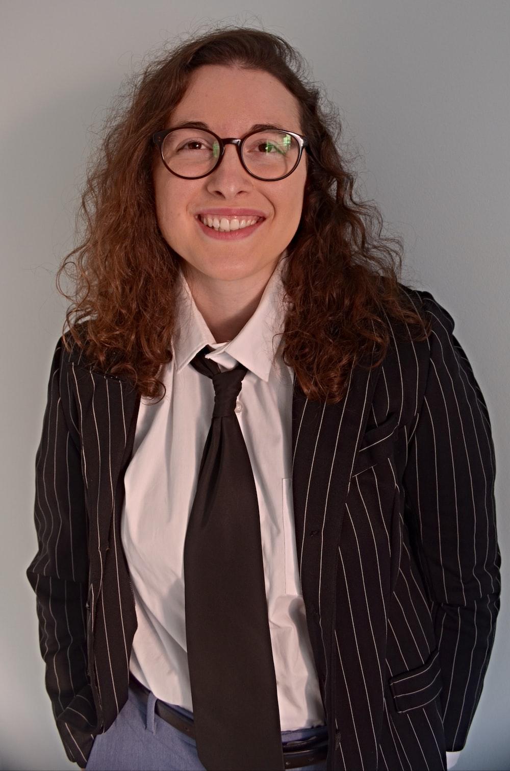 woman in black and white striped blazer wearing eyeglasses