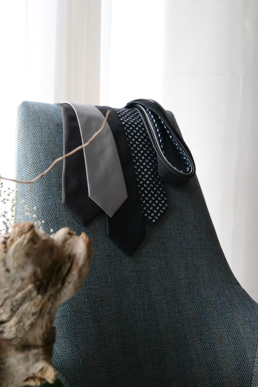 black and white polka dot bag on gray textile