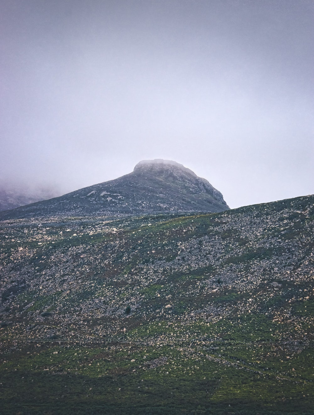 green and white mountain under white sky during daytime