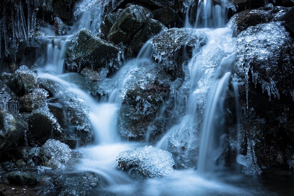 water falls in black rocks