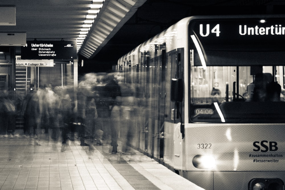 grayscale photo of train in the city