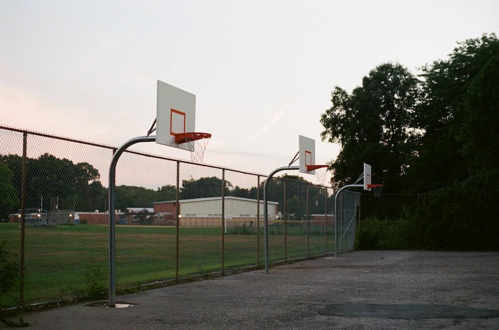 basketball hoop on green grass field during daytime